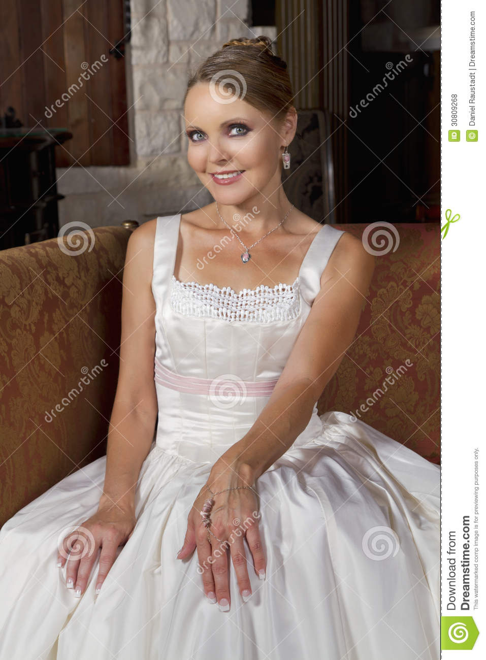 Beautiful bride in wedding gown wearing a necklace royalty for Bracelet for wedding dress
