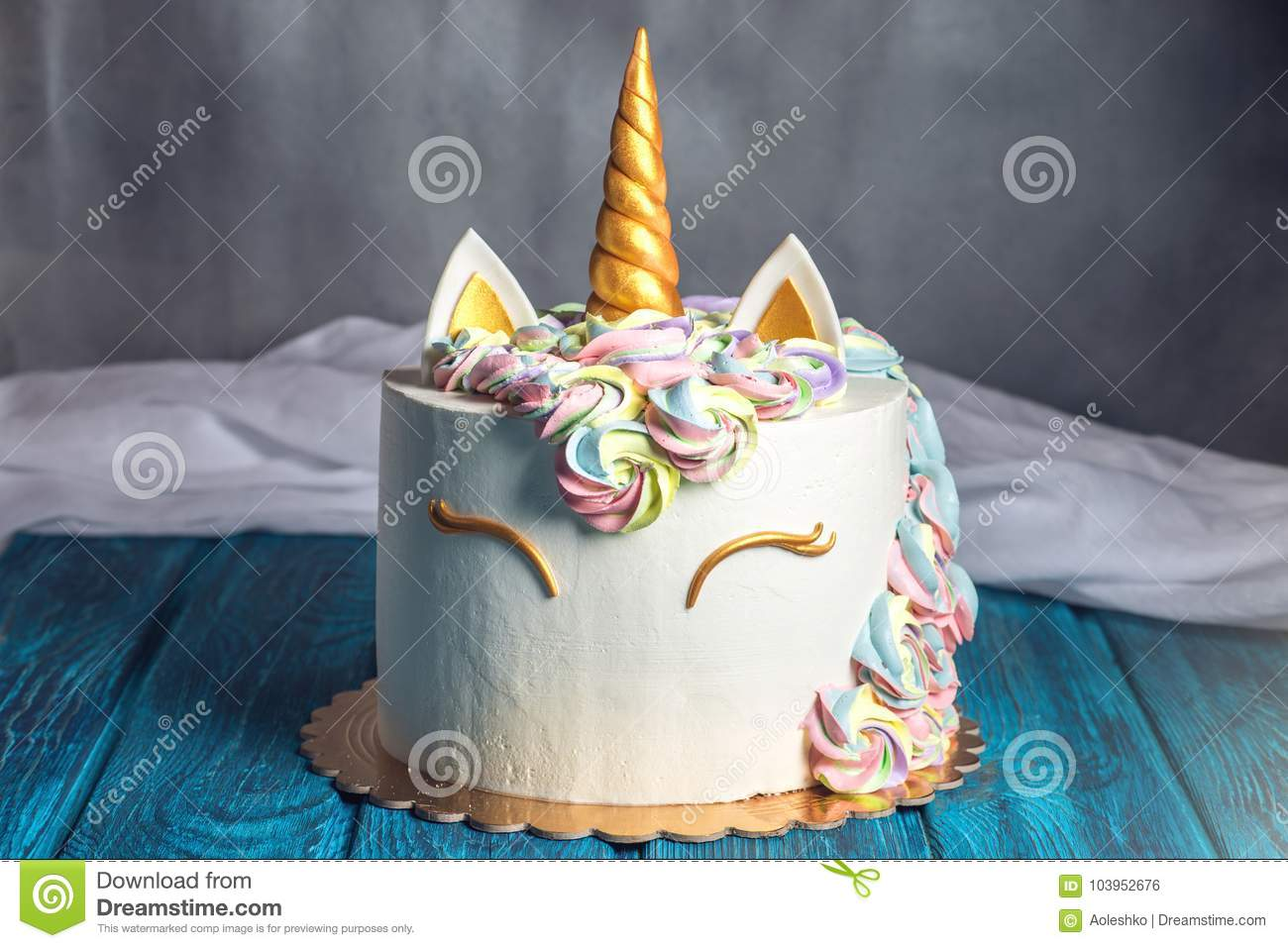 Beautiful bright cake decorated in the form of fantasy unicorn. Concept of a festive dessert for kids birthday