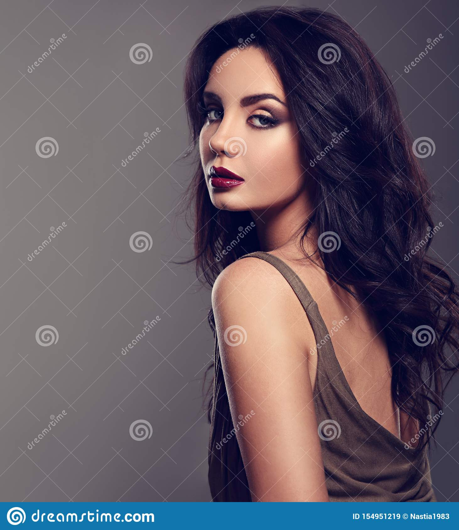 Beautiful Bright Makeup Woman With Long Black Curly Hair