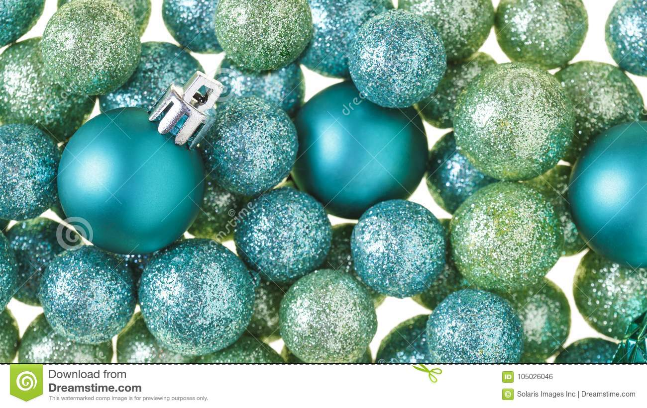 Beautiful, bright, modern Christmas holiday decorations ornaments background with sparkling luxe glitter balls