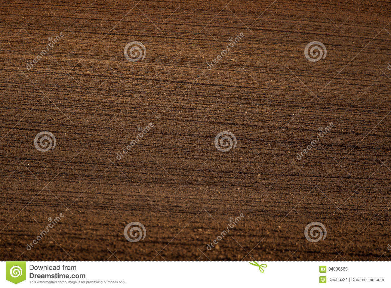A beautiful brown pattern on a field in spring. Abstract, textured background