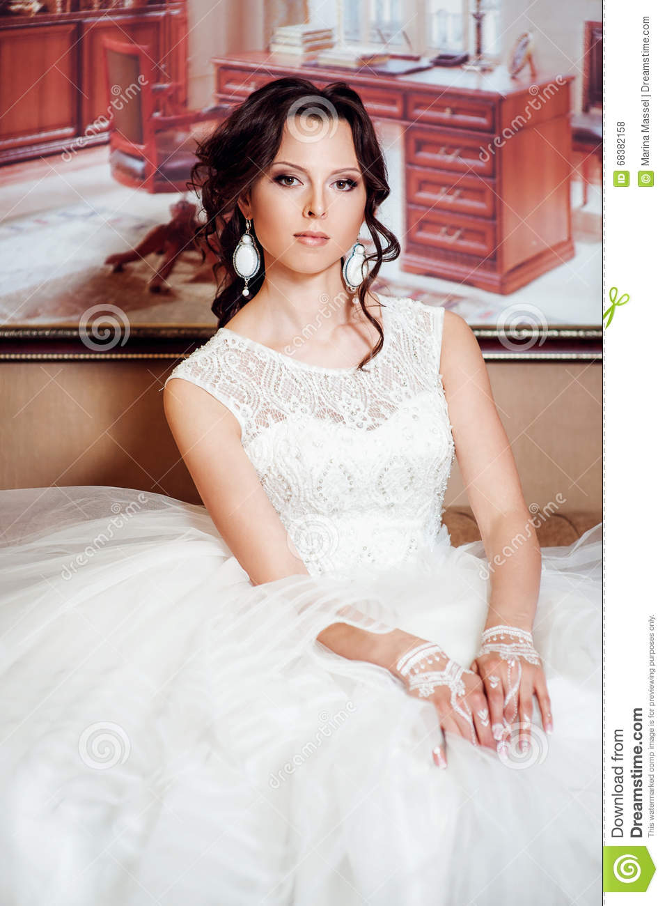 Brunette Woman With Long And Shiny Curly Hair Stock Image