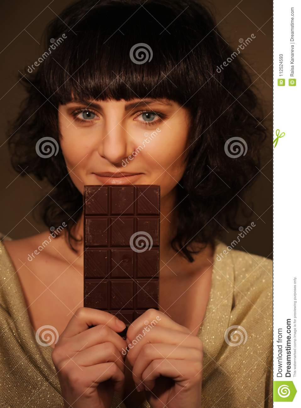 Beautiful Girl With Chocolate On Beige Background Stock Image