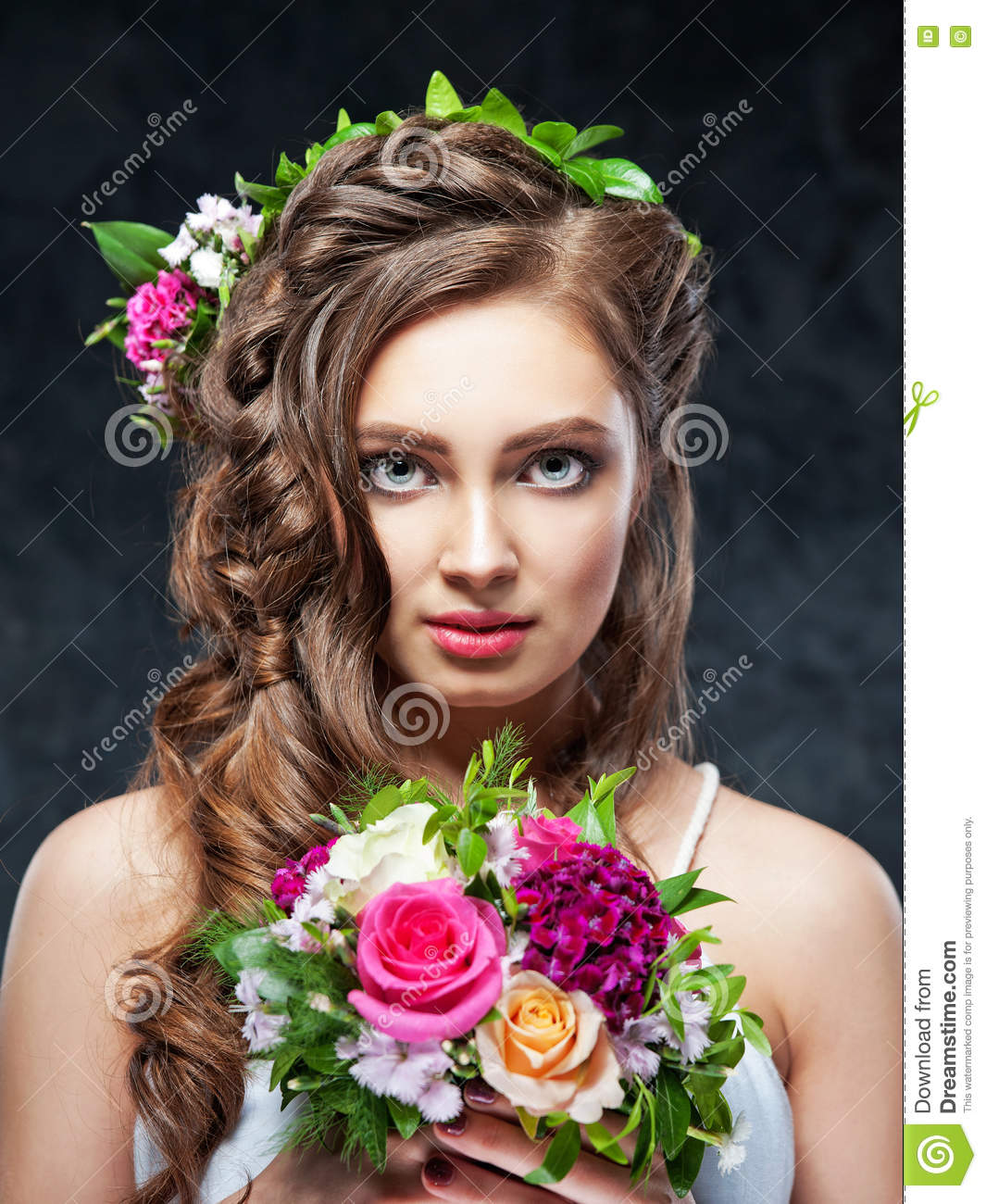 Beautiful Brunette Girl With A Composition Of Flowers Stock Photo