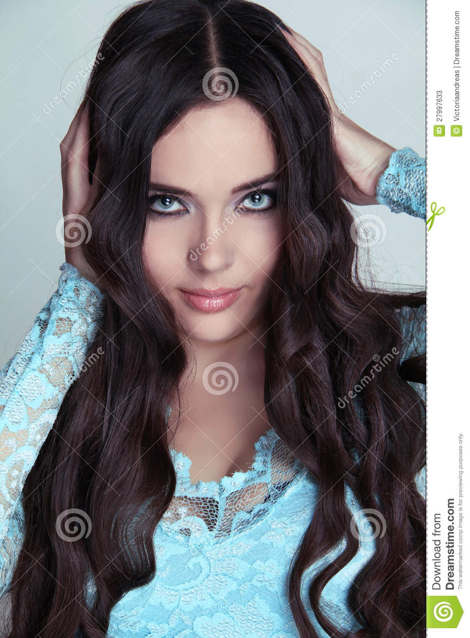 Beautiful Brunette Girl. Healthy Long Curly Hair. Stock