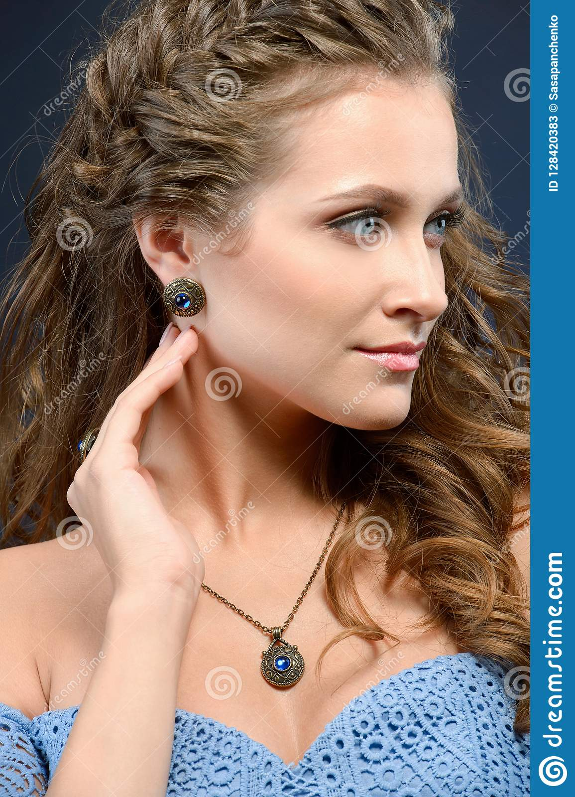 Beautiful brunette model girl with long curly hair and jewelry e