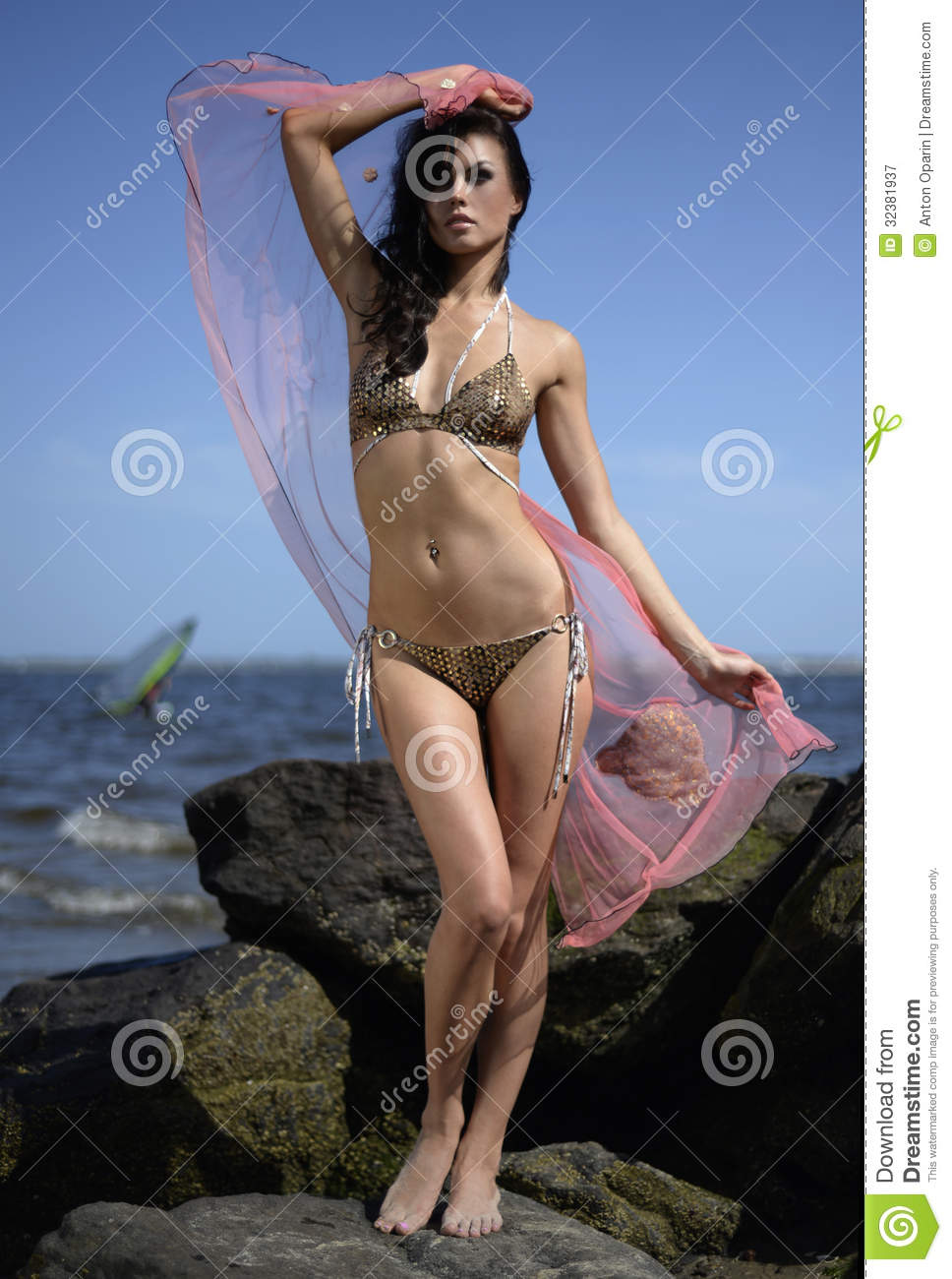 Sexy Model In Design Bikini And Cover Up Posing On The ...