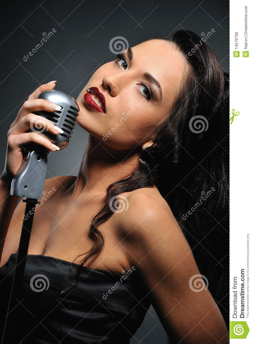 beautiful brunette with a retro microphone