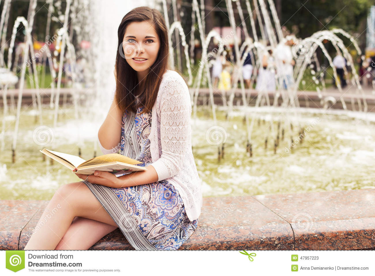 Beautiful brunette senior woman studying for her exams sitting n