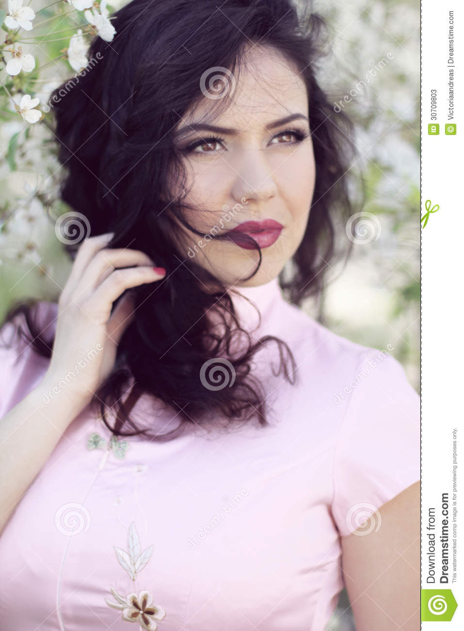 Beautiful Brunette Woman In Cherry Blossom Branch Spring