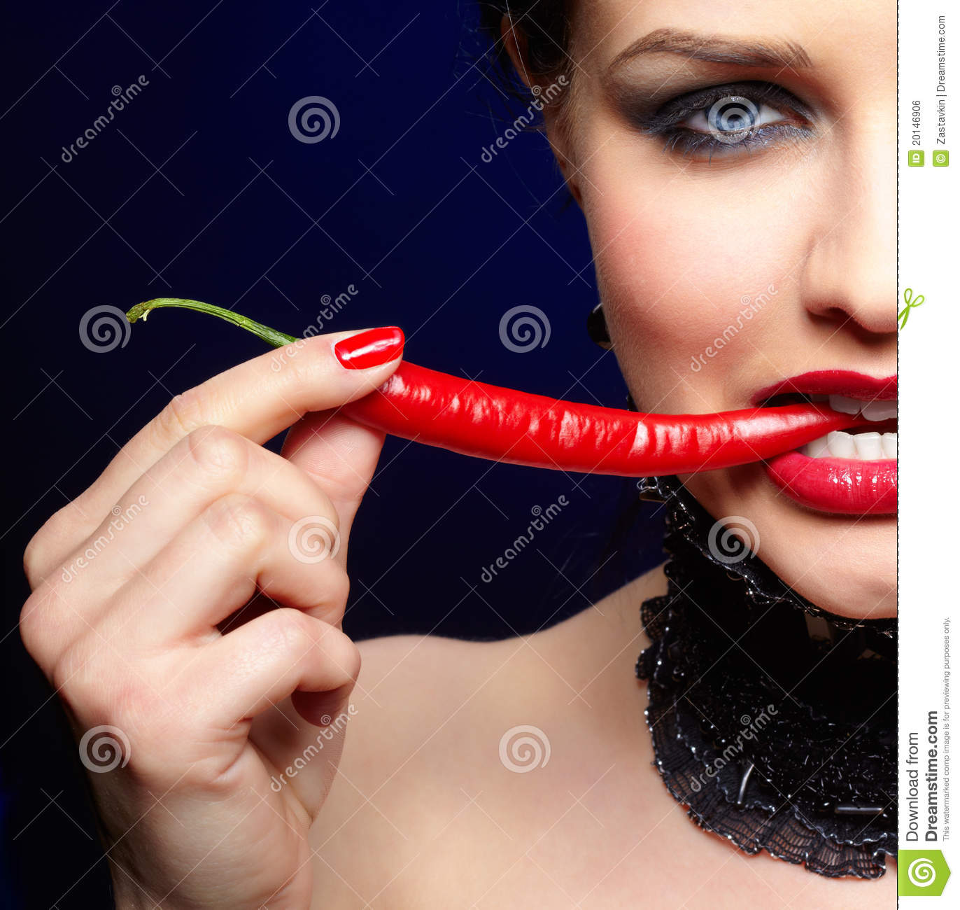 Beautiful brunette woman with chili pepper