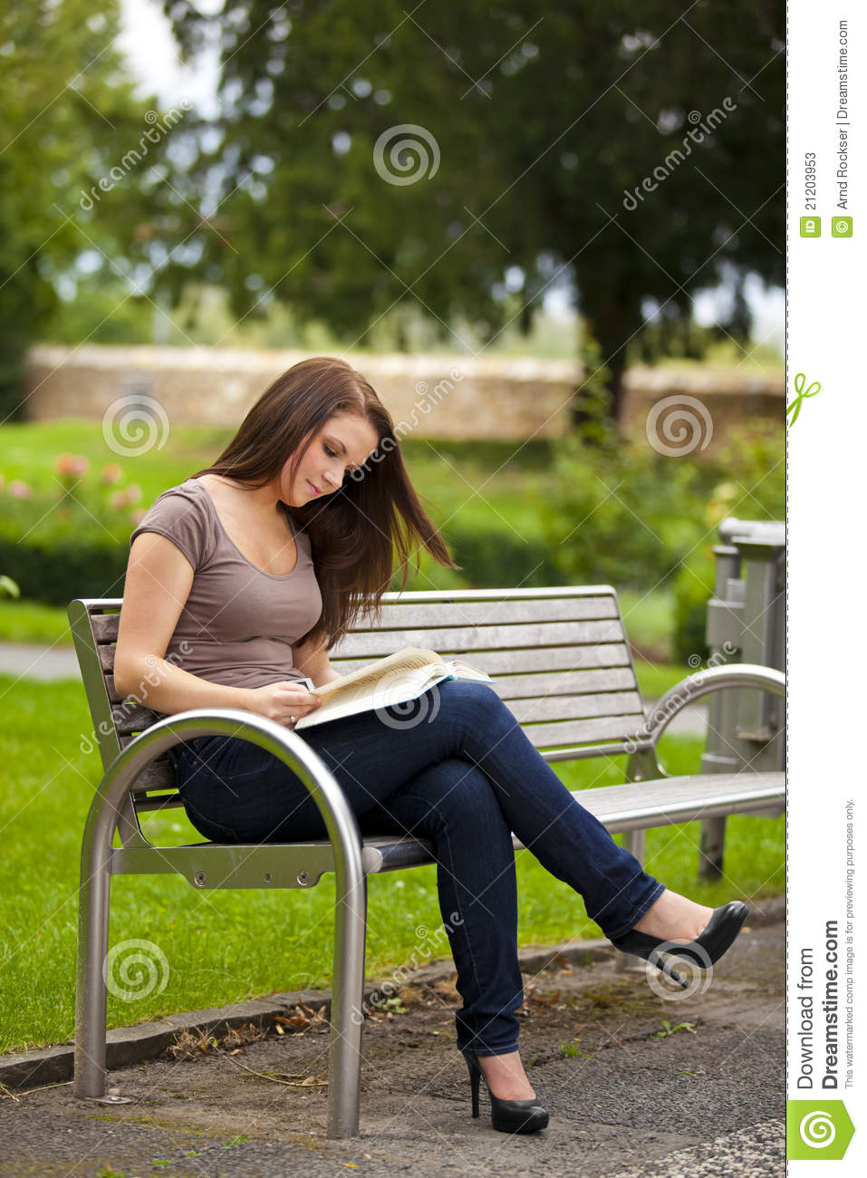 Beautiful Brunette Woman Reading A Book Stock Image