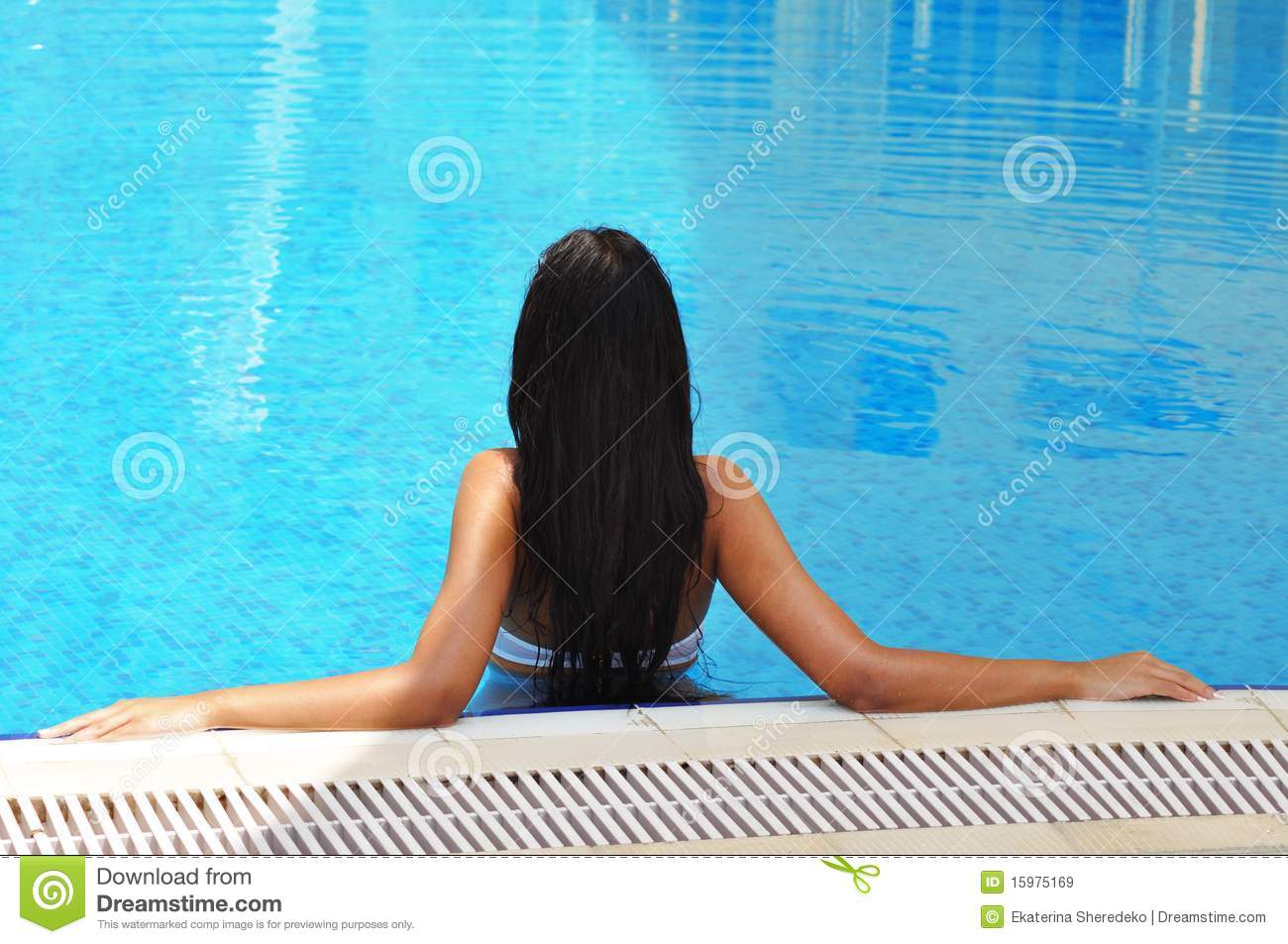 Beautiful brunette woman in a swimming pool royalty free Swimming pool beautiful
