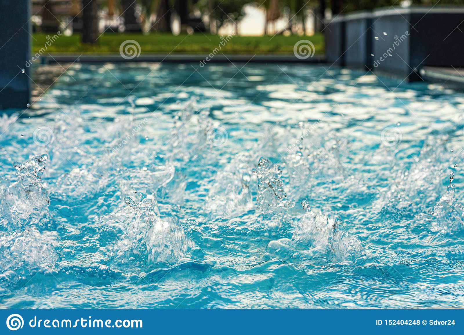 Blue clear fresh Water in jacuzzi. Spa massage background. azure color