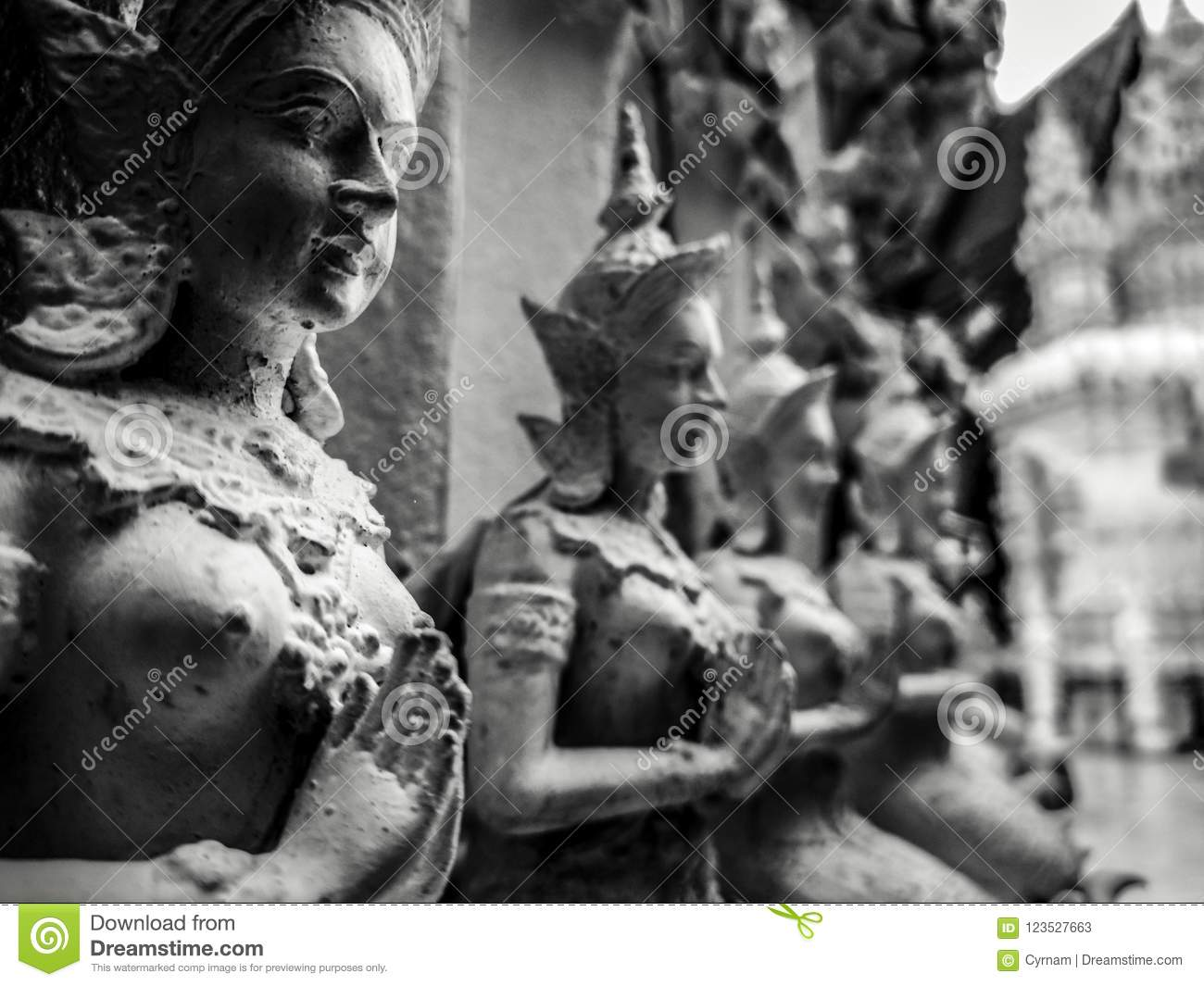 Beautiful buddhist sculpture hands clasped in prayer, detail of buddhist figures carved in Wat Sanpayangluang at Lamphun, Thailand