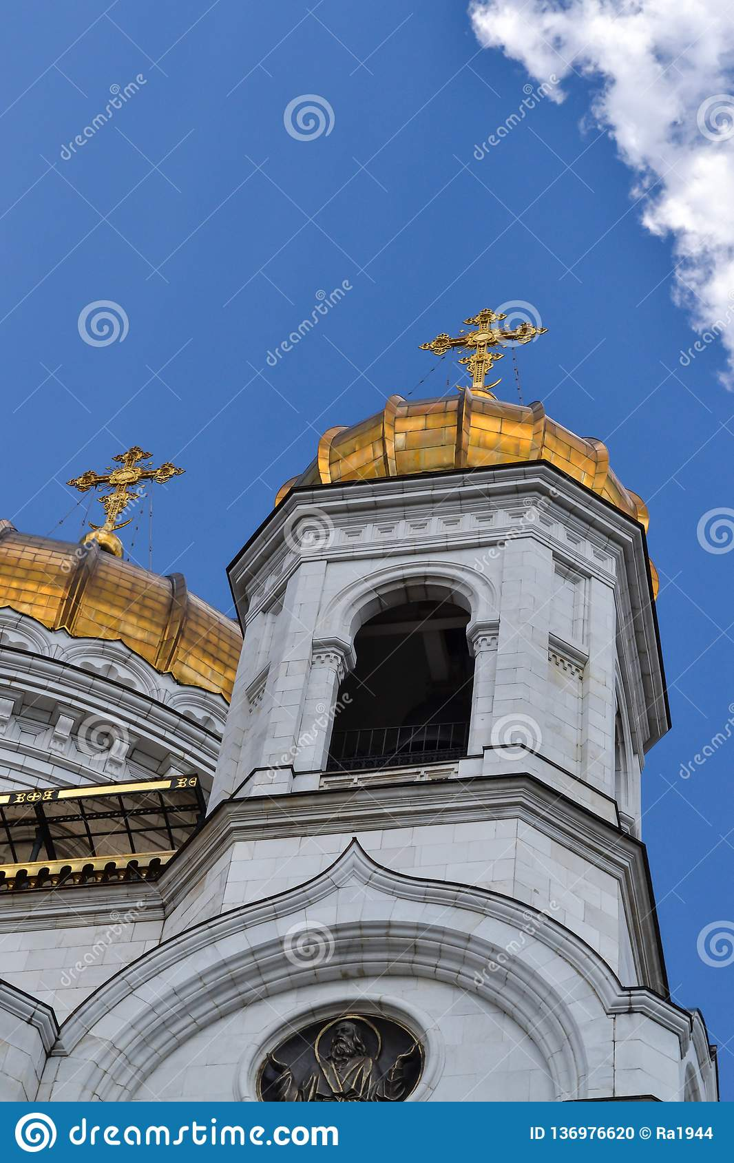 Beautiful building of the Russian Orthodox Church. Covered in gold dome. Crosses and exterior decoration. Love to God