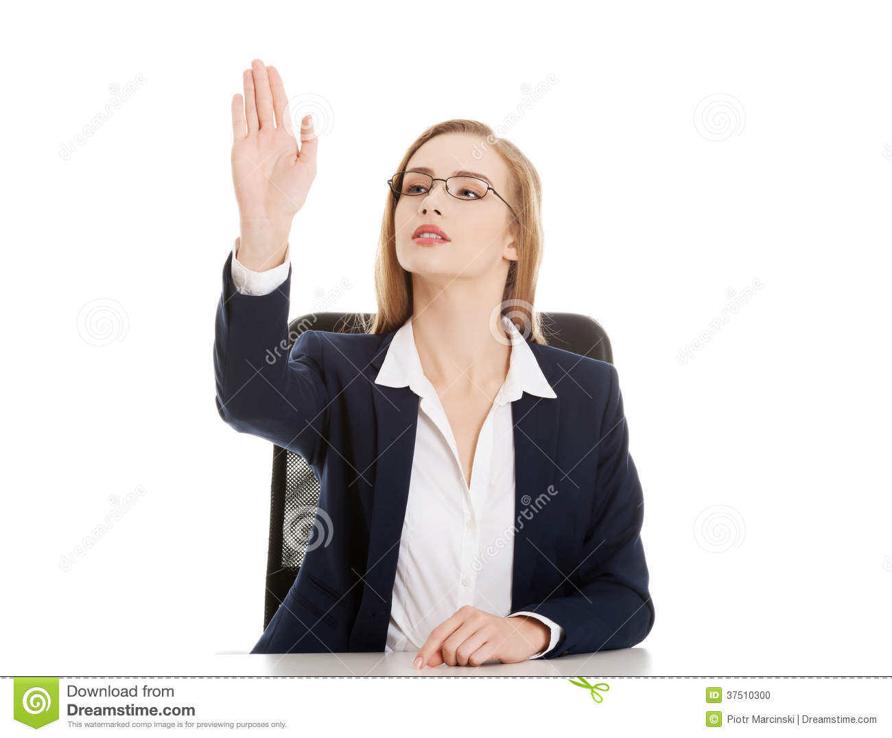 Beautiful business woman is sitting and showing stop gesture.