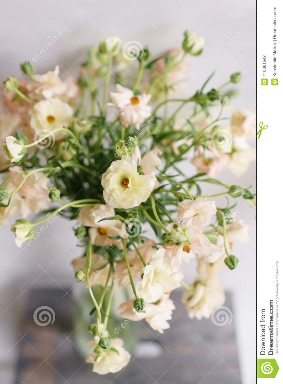 Beautiful Buttercups Bush Flowers In A Vase On A Table Bouquet Of