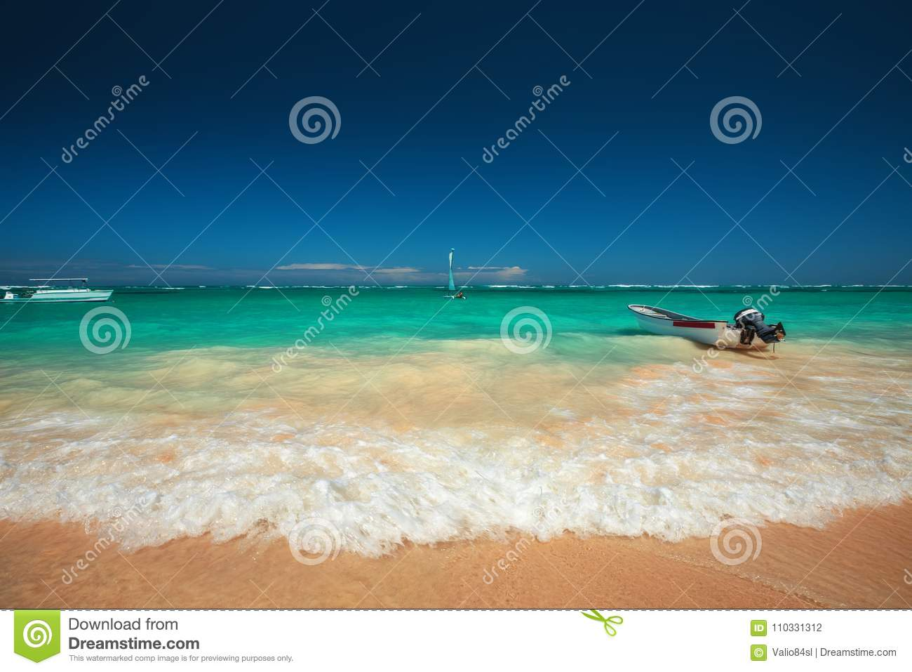 Caribbean sea and boat on the shore, beautiful panoramic view