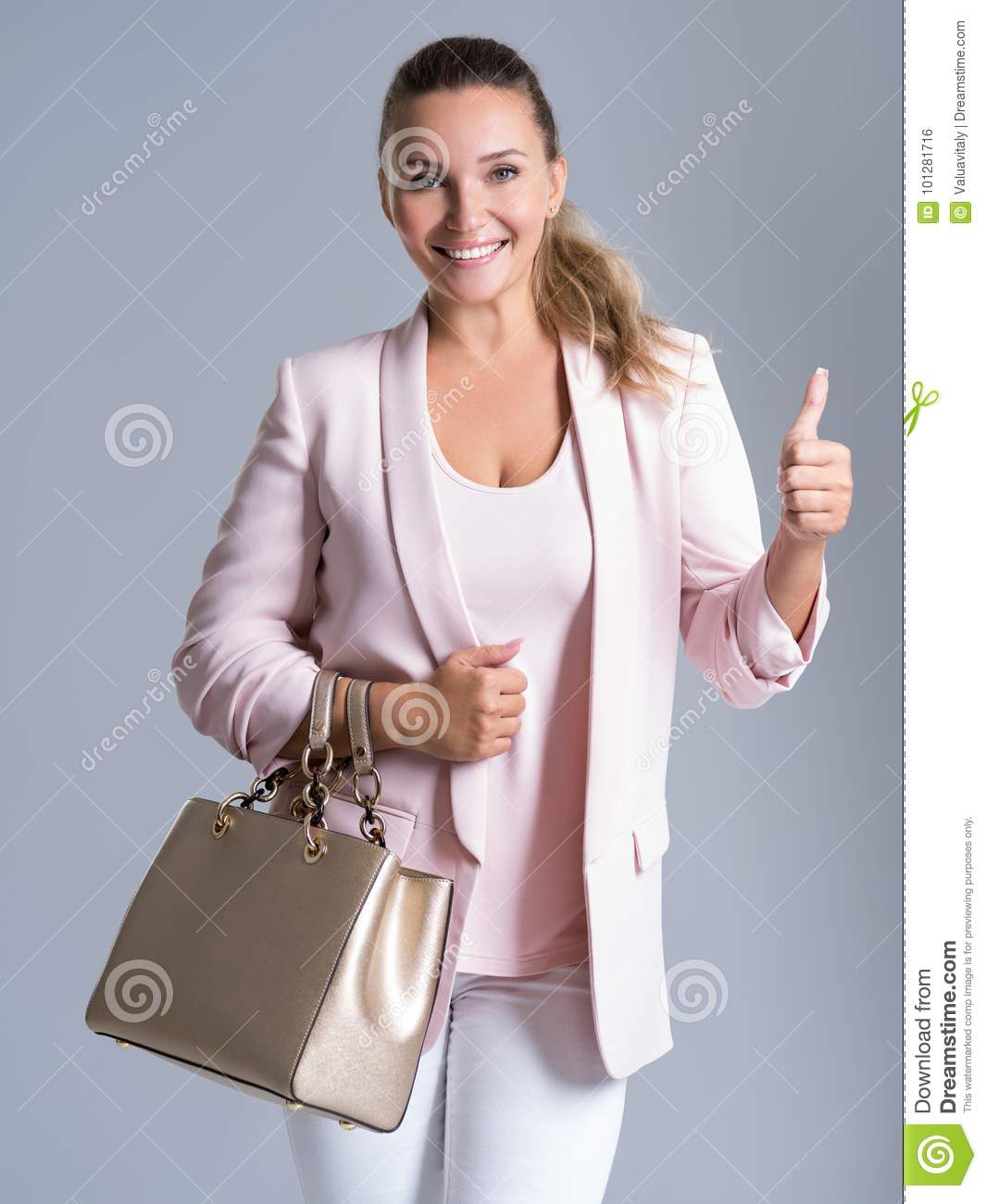 Beautiful casual adult smiling woman with thumb up.