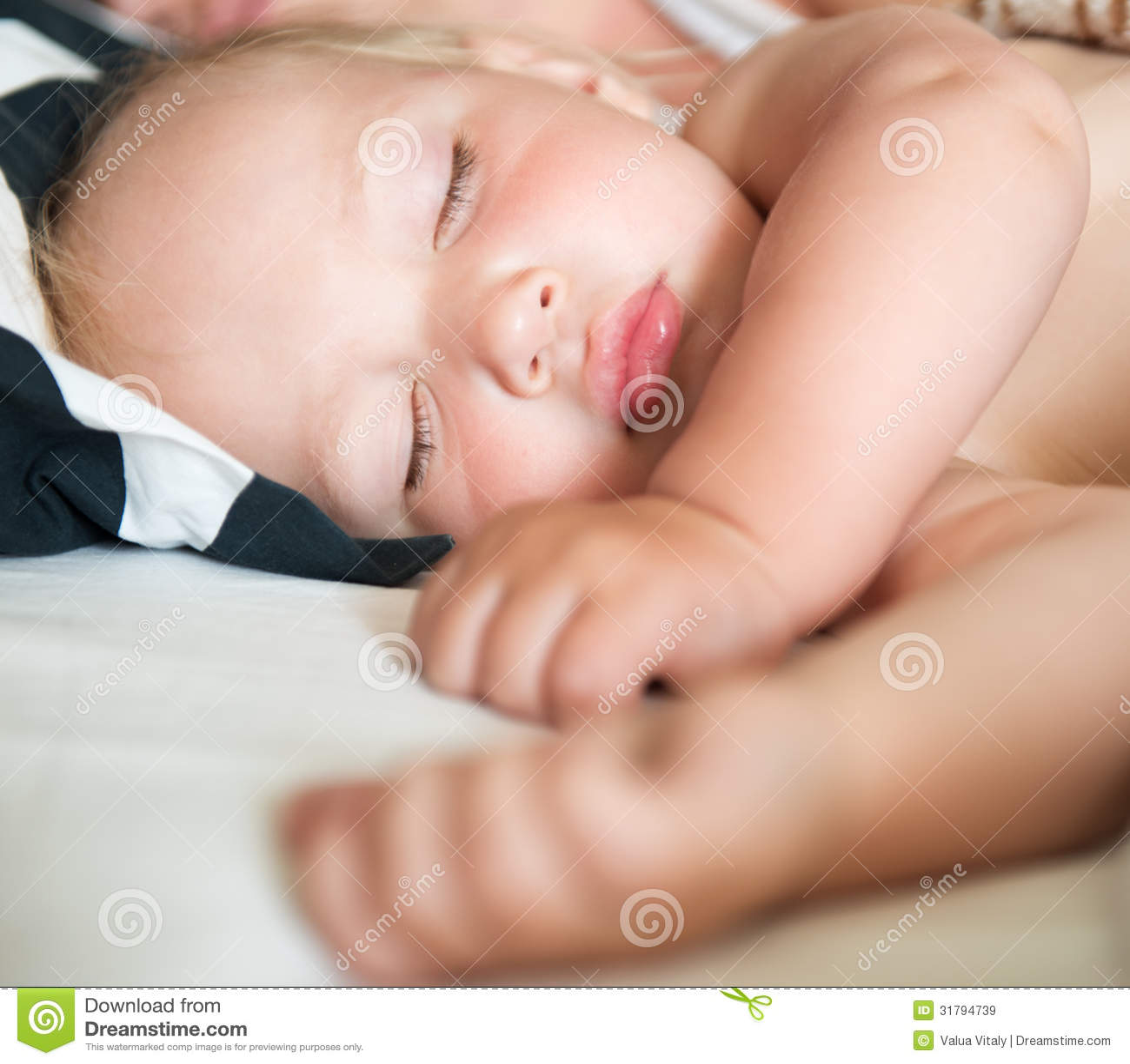 Beautiful Caucasian Baby Sleeping Lying On Side Royalty