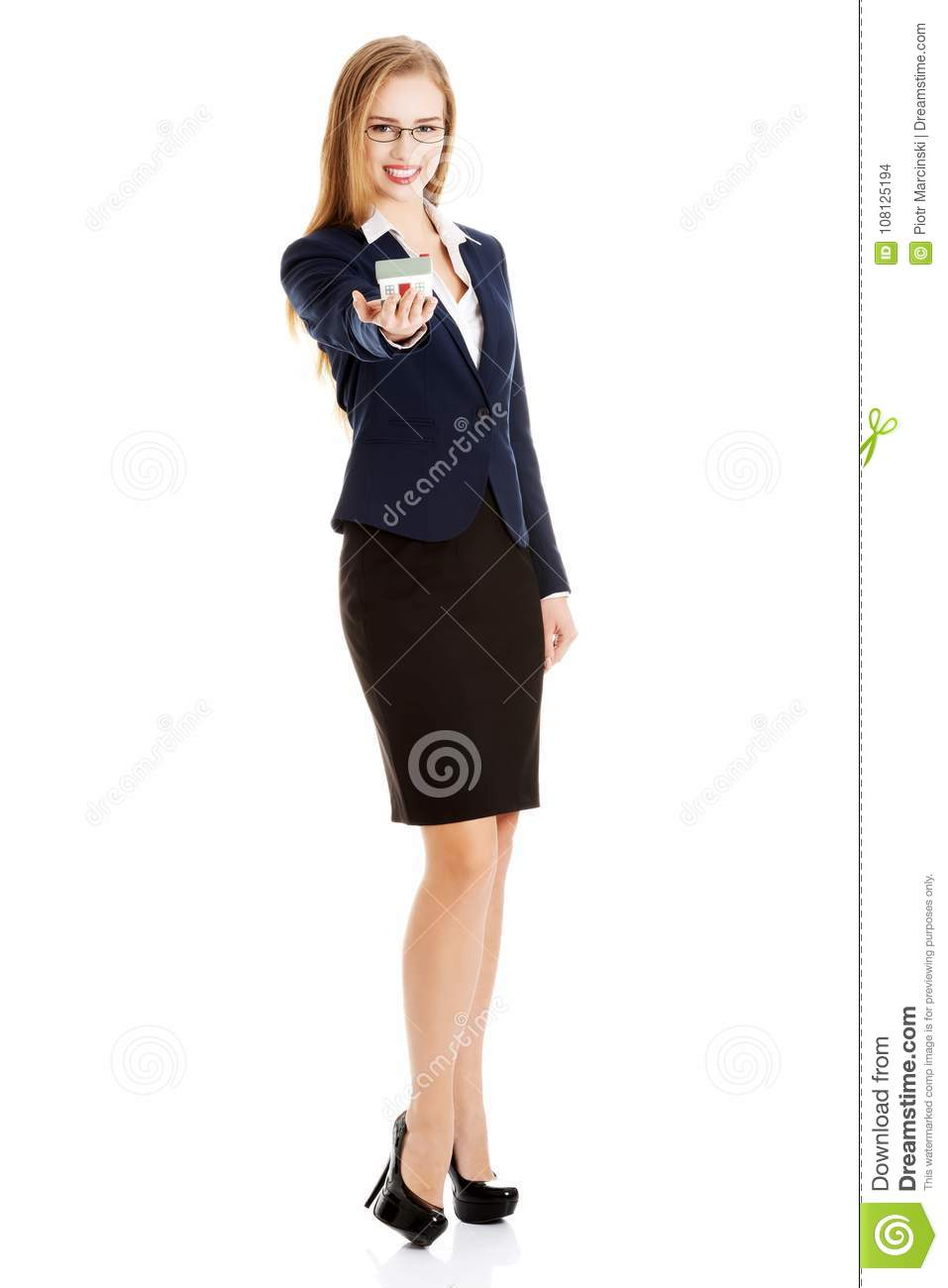 Beautiful caucasian business woman is holding house model.