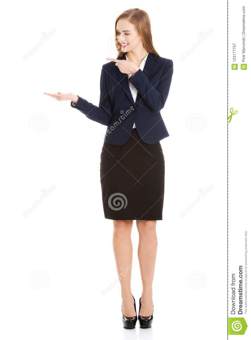 Beautiful caucasian business woman pointing on copy space on her side.