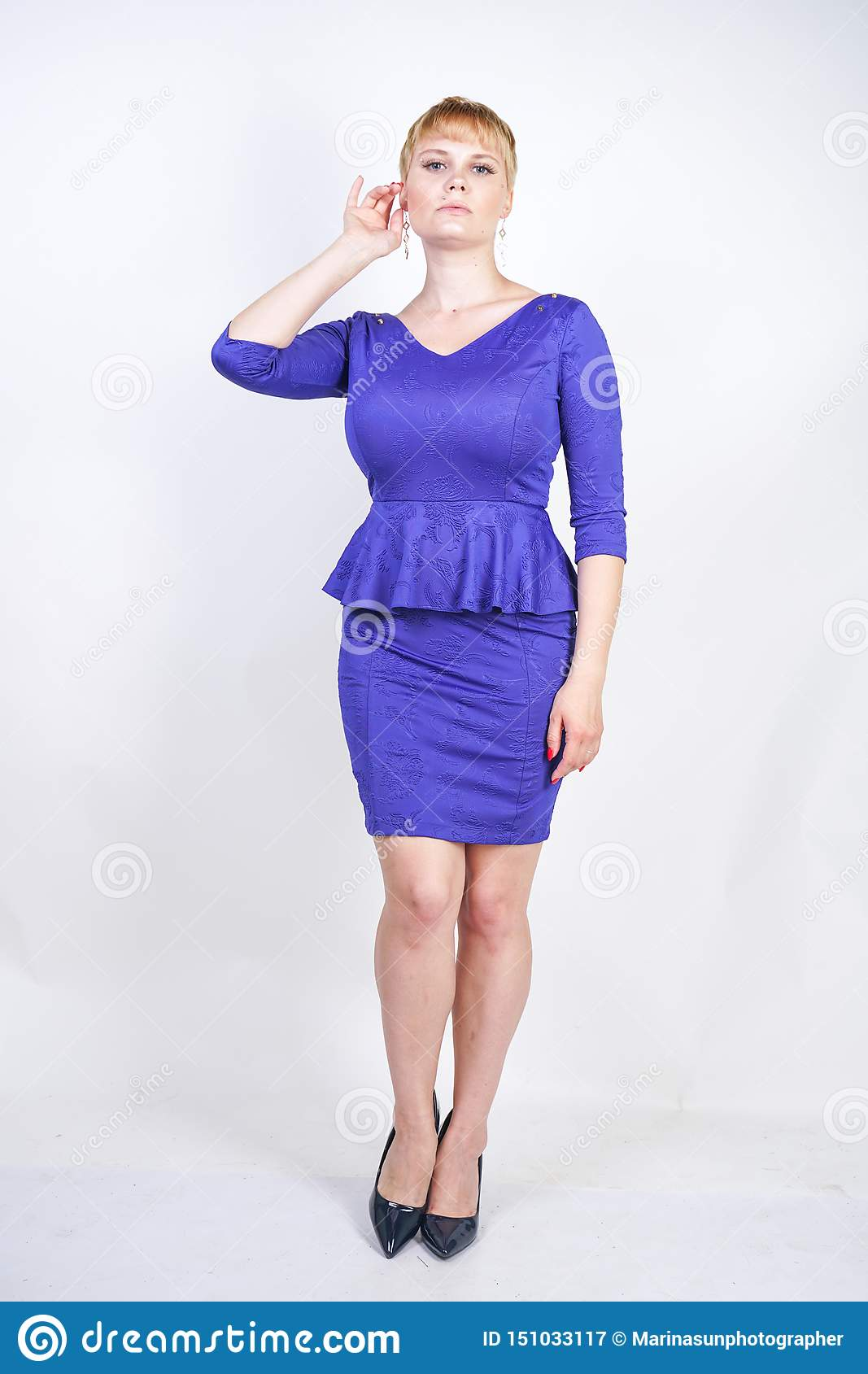Beautiful Caucasian Girl With Short Hair And Plus Size Body Dressed In Blue Medium Length Dress In Business Style With Peplum At T Stock Image Image Of Figure Business 151033117