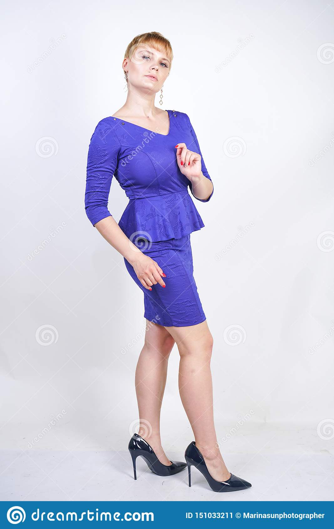 Beautiful Caucasian Girl With Short Hair And Plus Size Body Dressed In Blue Medium Length Dress In Business Style With Peplum At T Stock Image Image Of Body Clothes 151033211