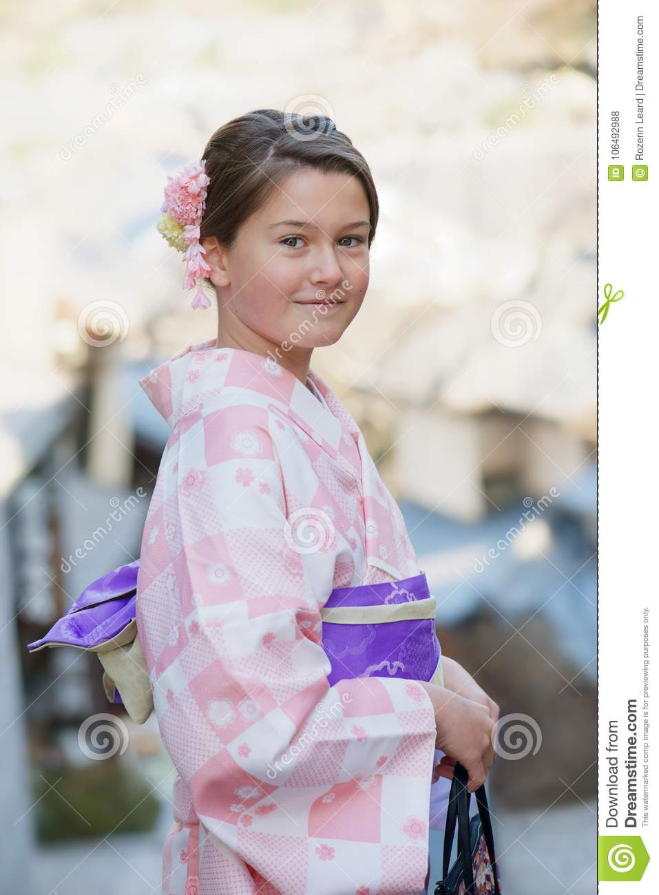 Caucasian Girl Wearing A Traditional Japanese Kimono Stock Photo