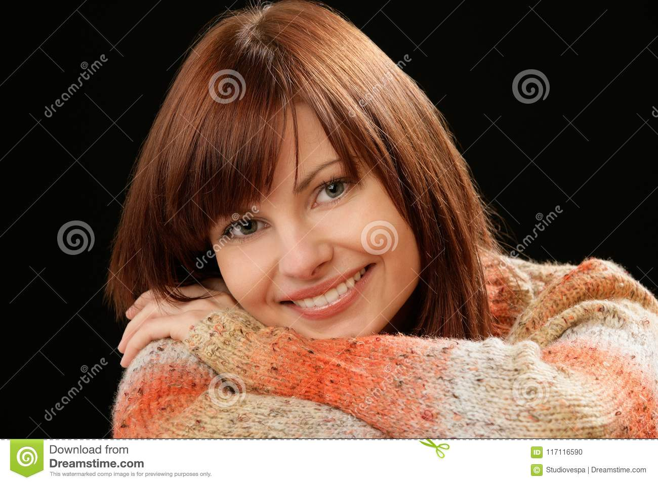 Beautiful Caucasian smiling young female model with red hair