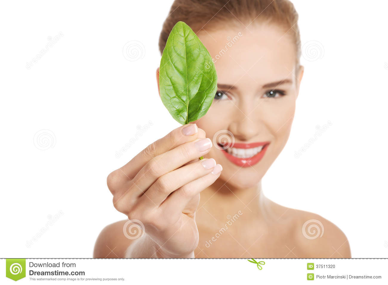 Beautiful caucasian topless woman with one green leaf.