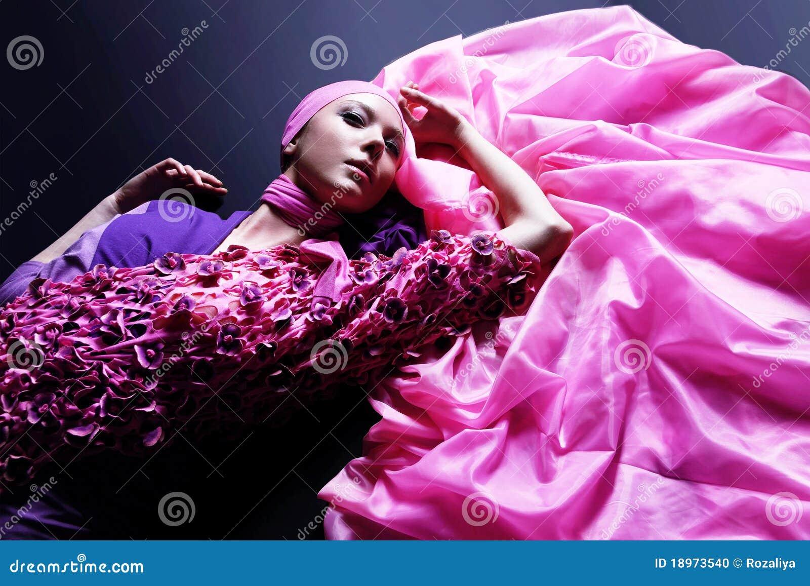 Beautiful caucasian woman in pink elegant dress