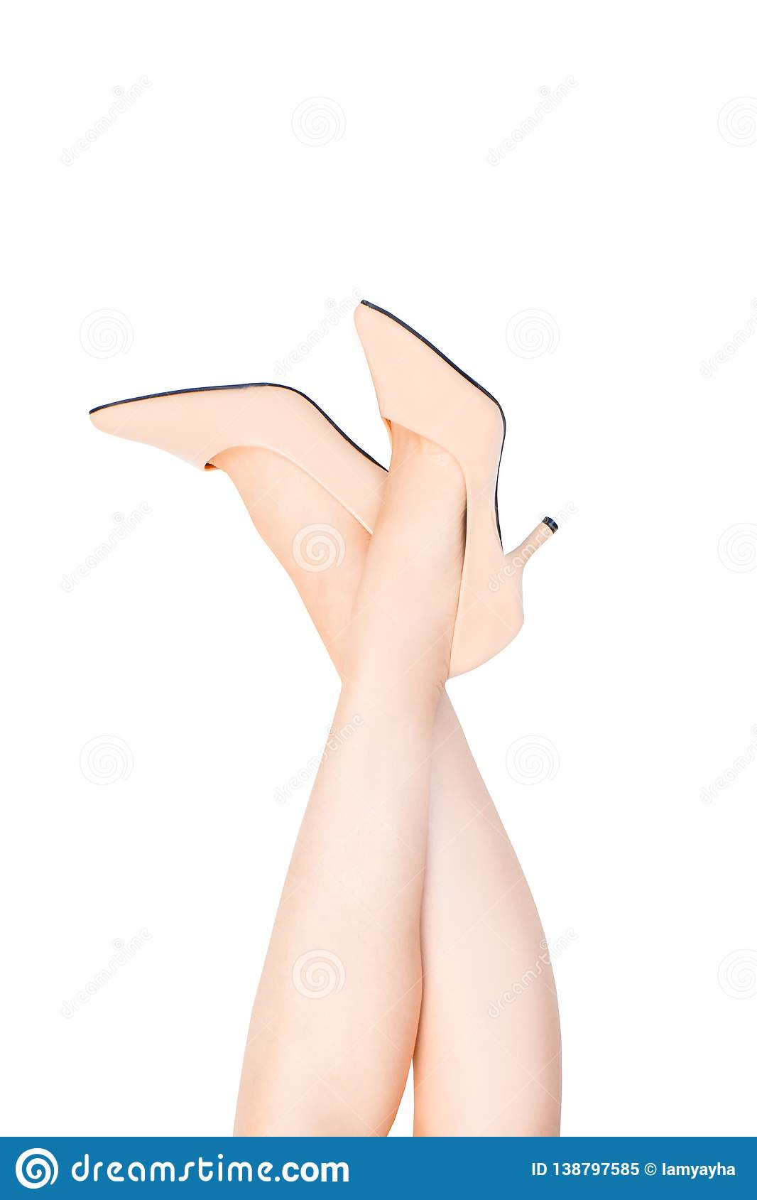 Beautiful Caucasian Woman Legs Wearing Beige Medium High-Heels Shoes on White Color. Fashion Accessory Shoe Selfie. Female