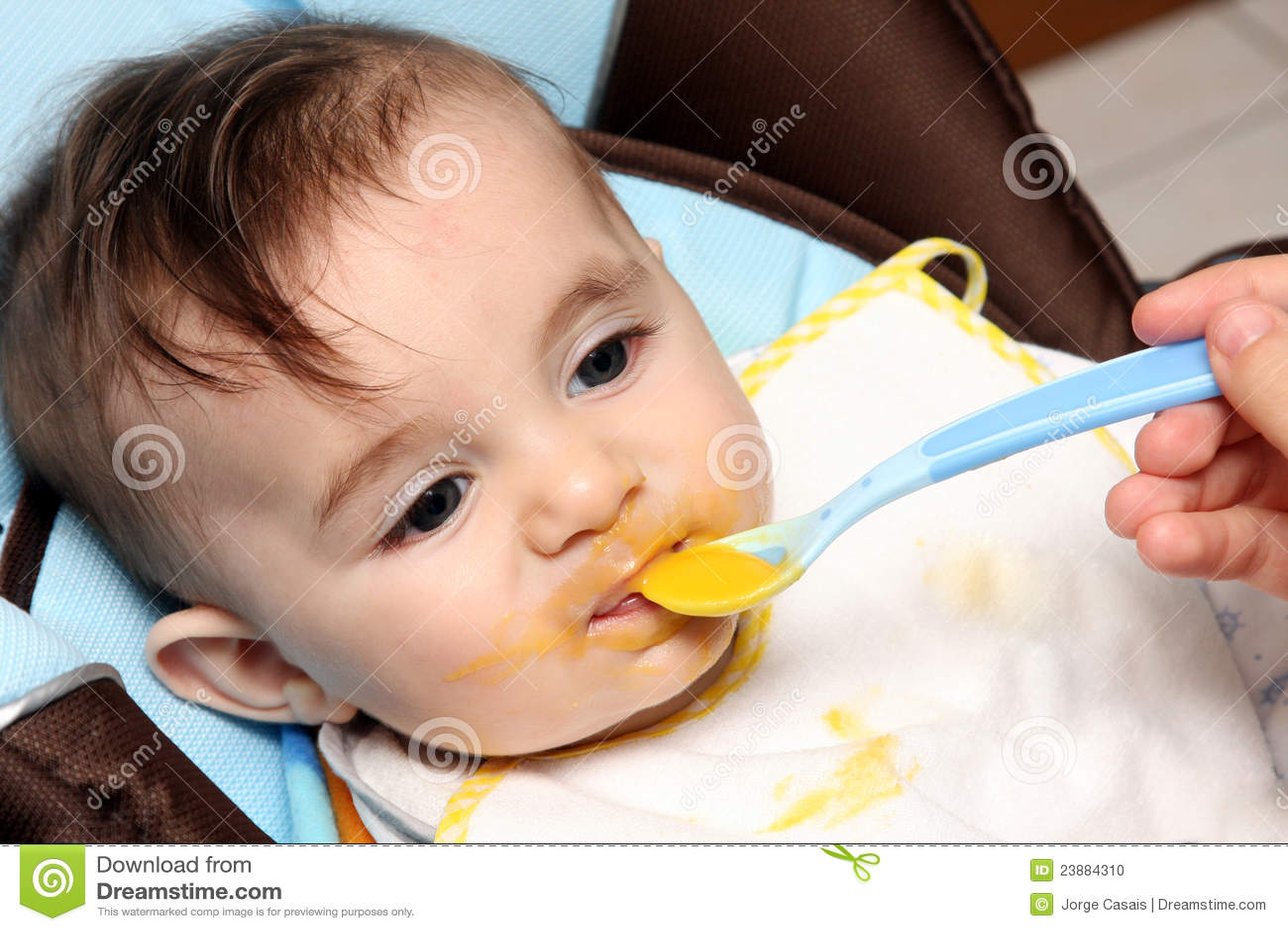 Beautiful child eating soup