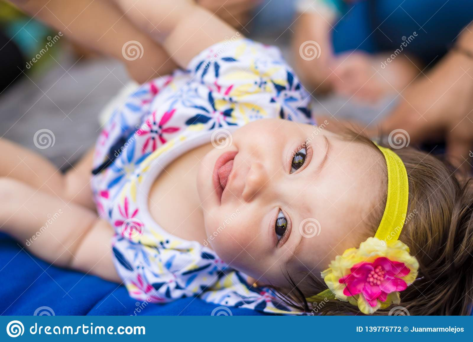 Beautiful child girl looking to the camera and smiling