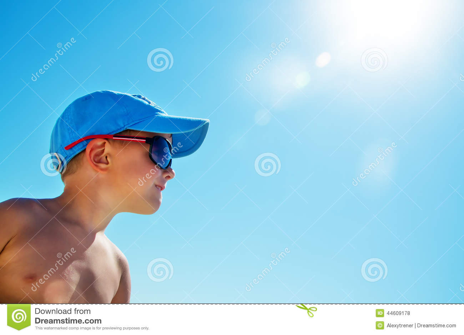 96d10268976c Beautiful Child Wearing Blue Cap On Beach Stock Photo - Image of ...