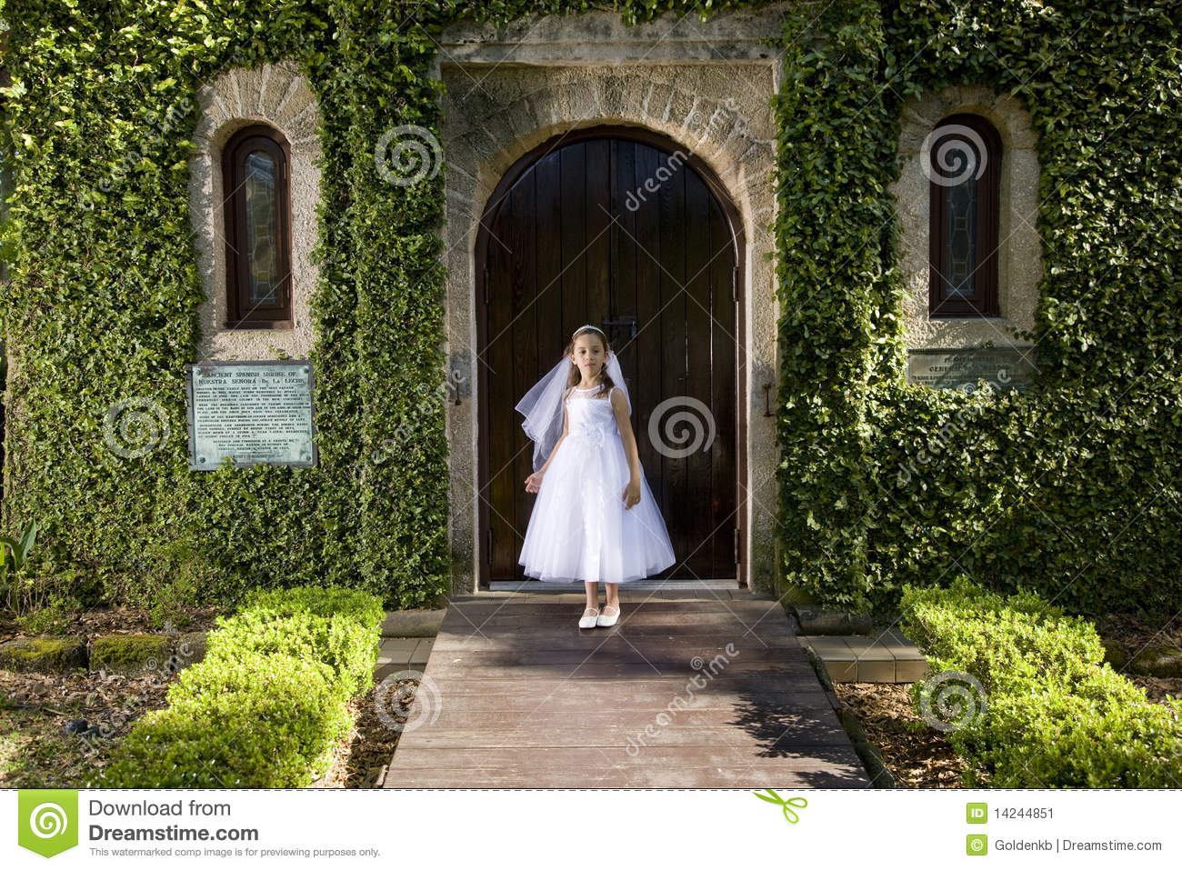Beautiful Child In White Dress Outside Chapel Stock Image