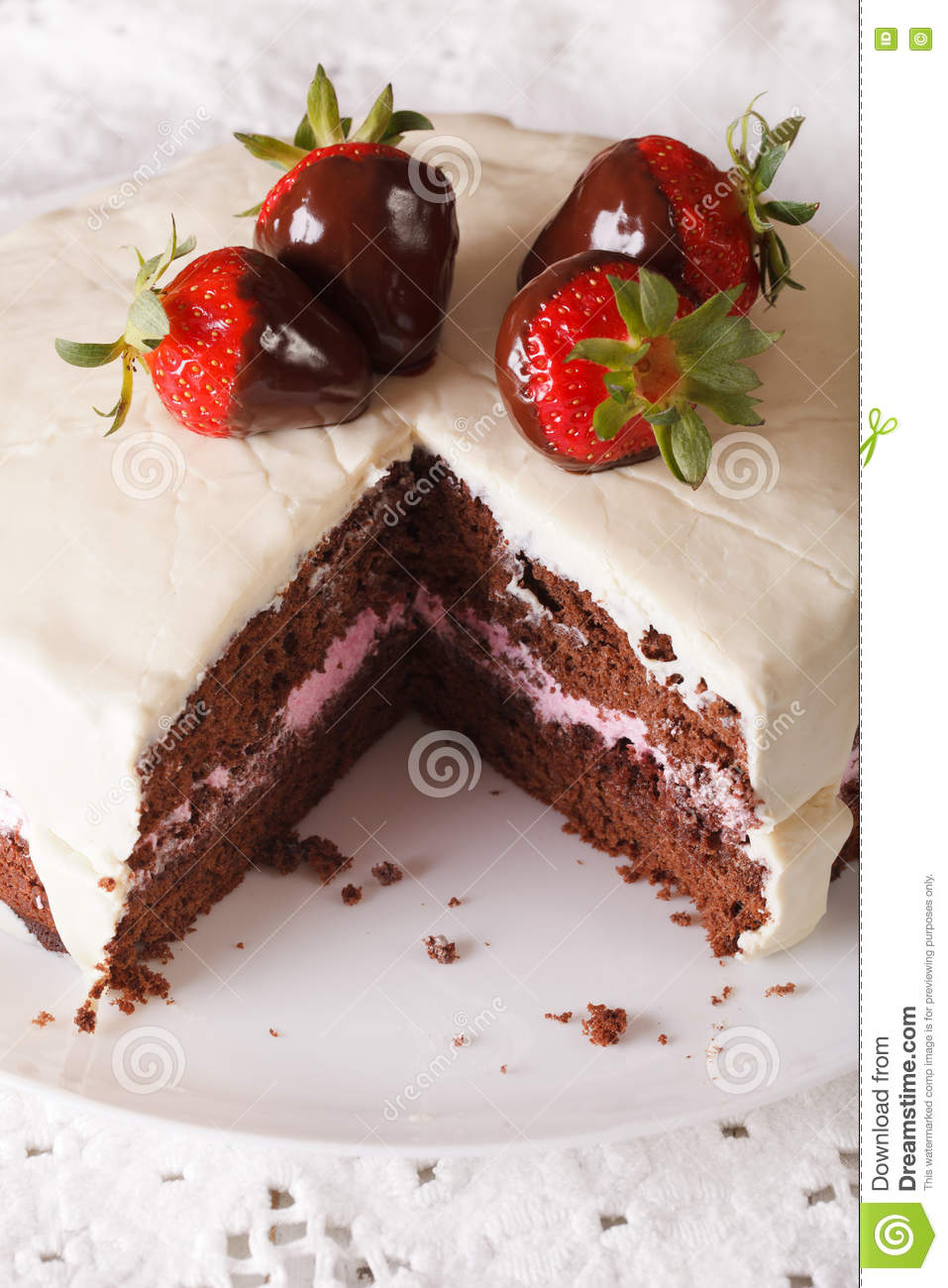 Beautiful Chocolate Cake With White Icing And Strawberries Close