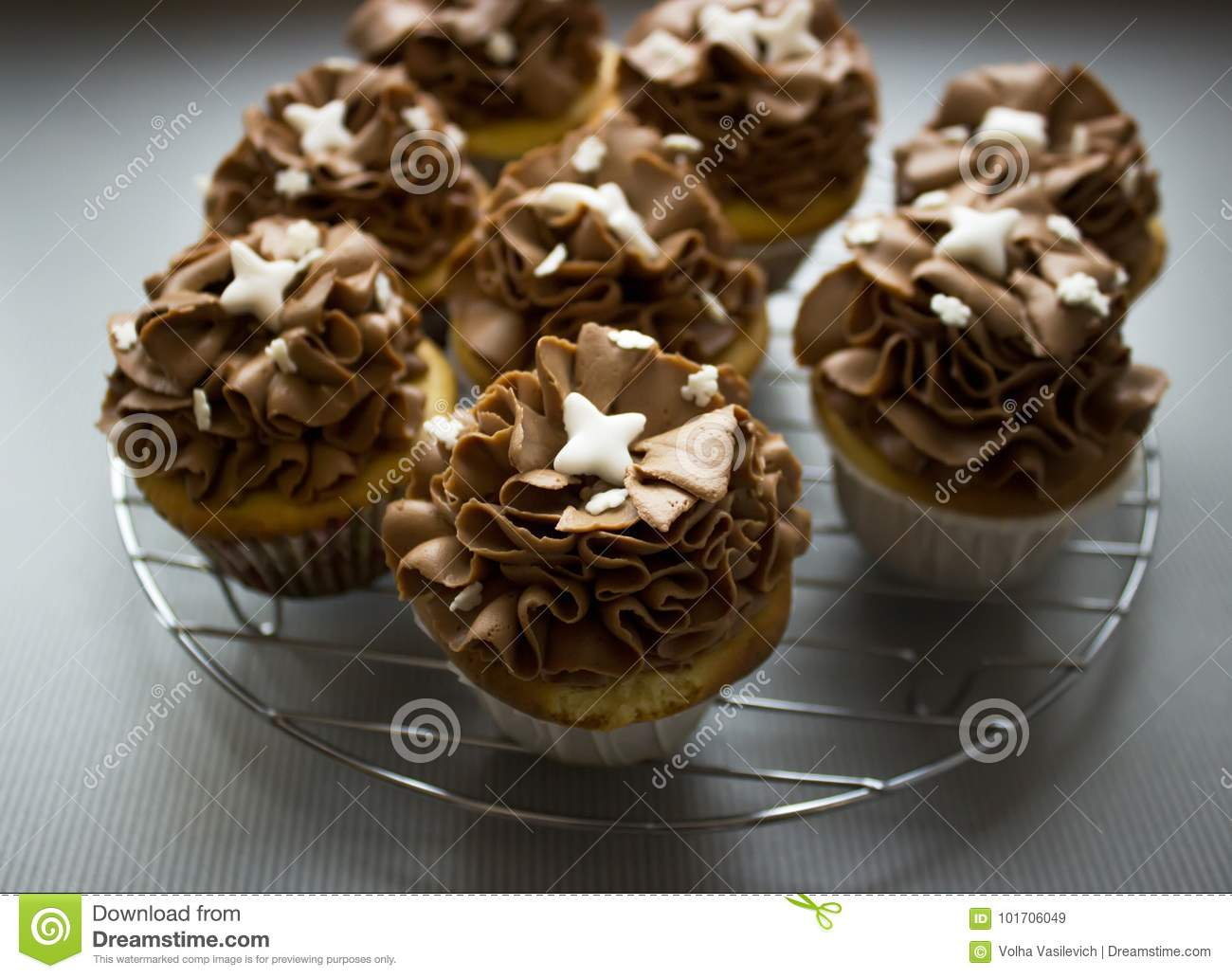 Beautiful Chocolate Cupcakes Standing On The Gray Background After
