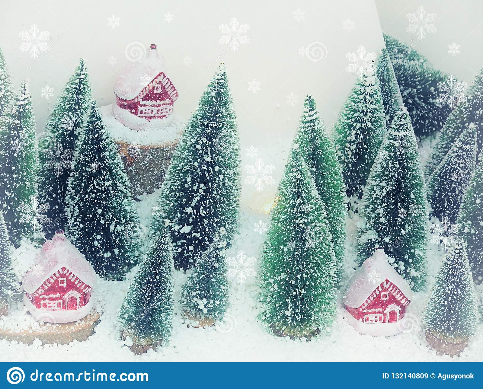 Beautiful Christmas background greeting card. Winter scenery snow forest and houses. New Year