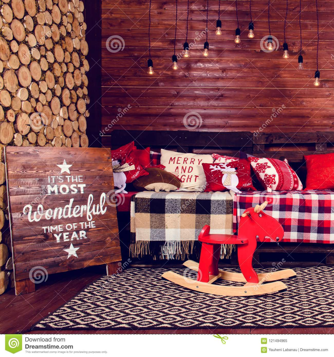 beautiful christmas interior design room decorated with wooden sofa with warm blanket lights teddy bear and wooden horse toned image