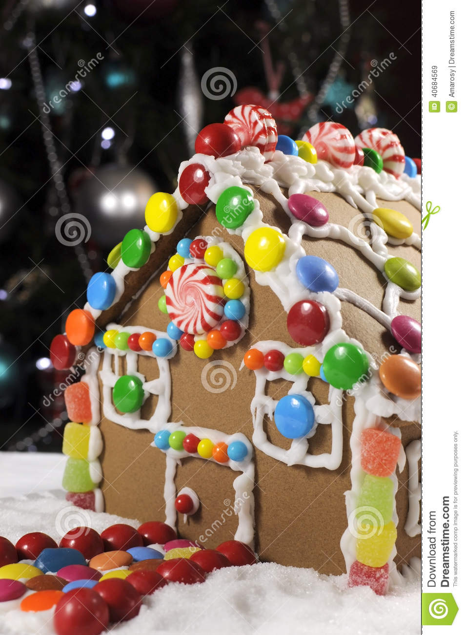 Beautiful Christmas Table Setting In Front Of Christmas Tree Featuring A Gingerbread House