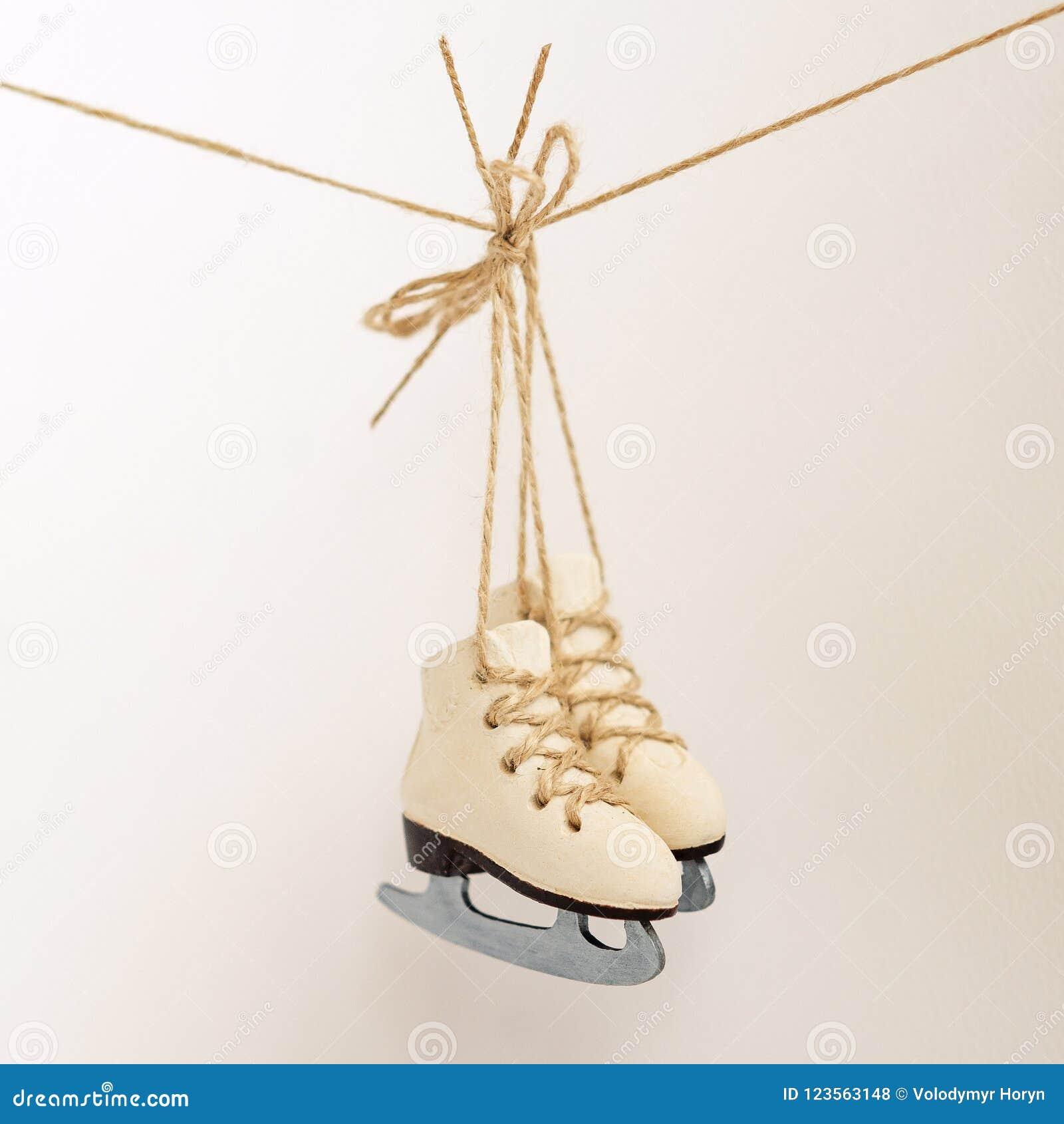 Сhristmas Tree Decoration Small Ice Skates On The Rope Stock Photo ...