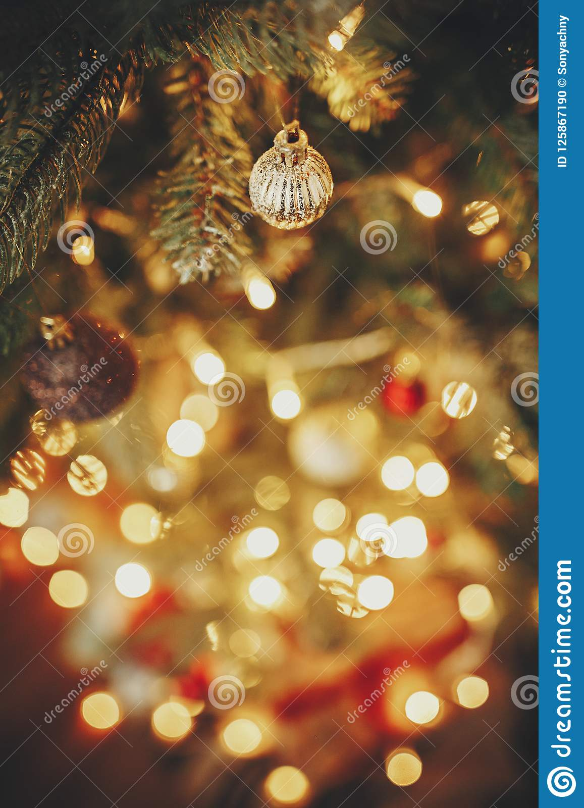 beautiful christmas tree with ornaments golden lights and prese - Beautiful Christmas Ornaments