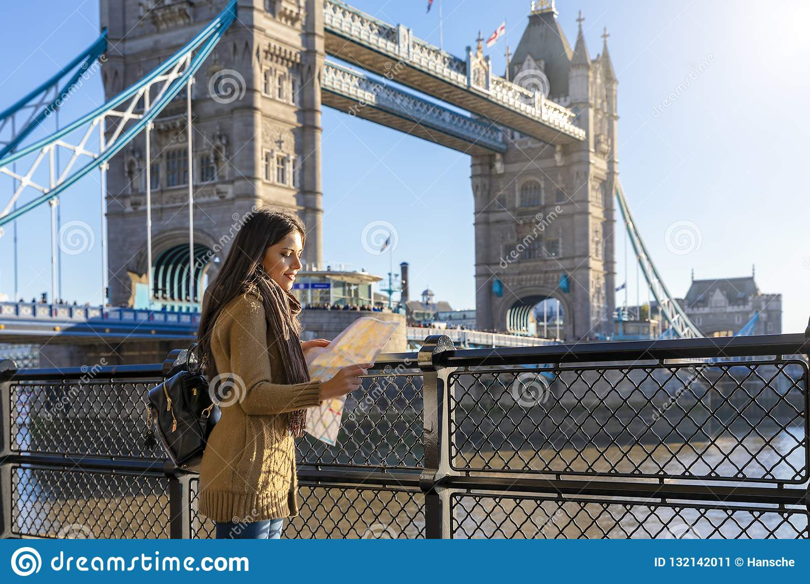 Urban city tourist concept in front of Tower Bridge in London,UK