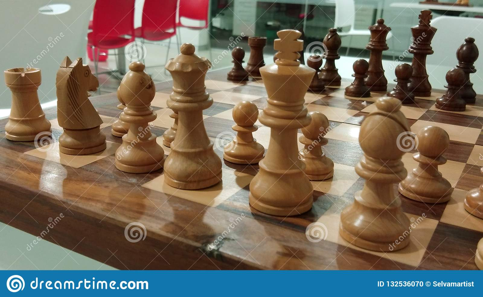 The traditional chess piece on chess board ready for battle.