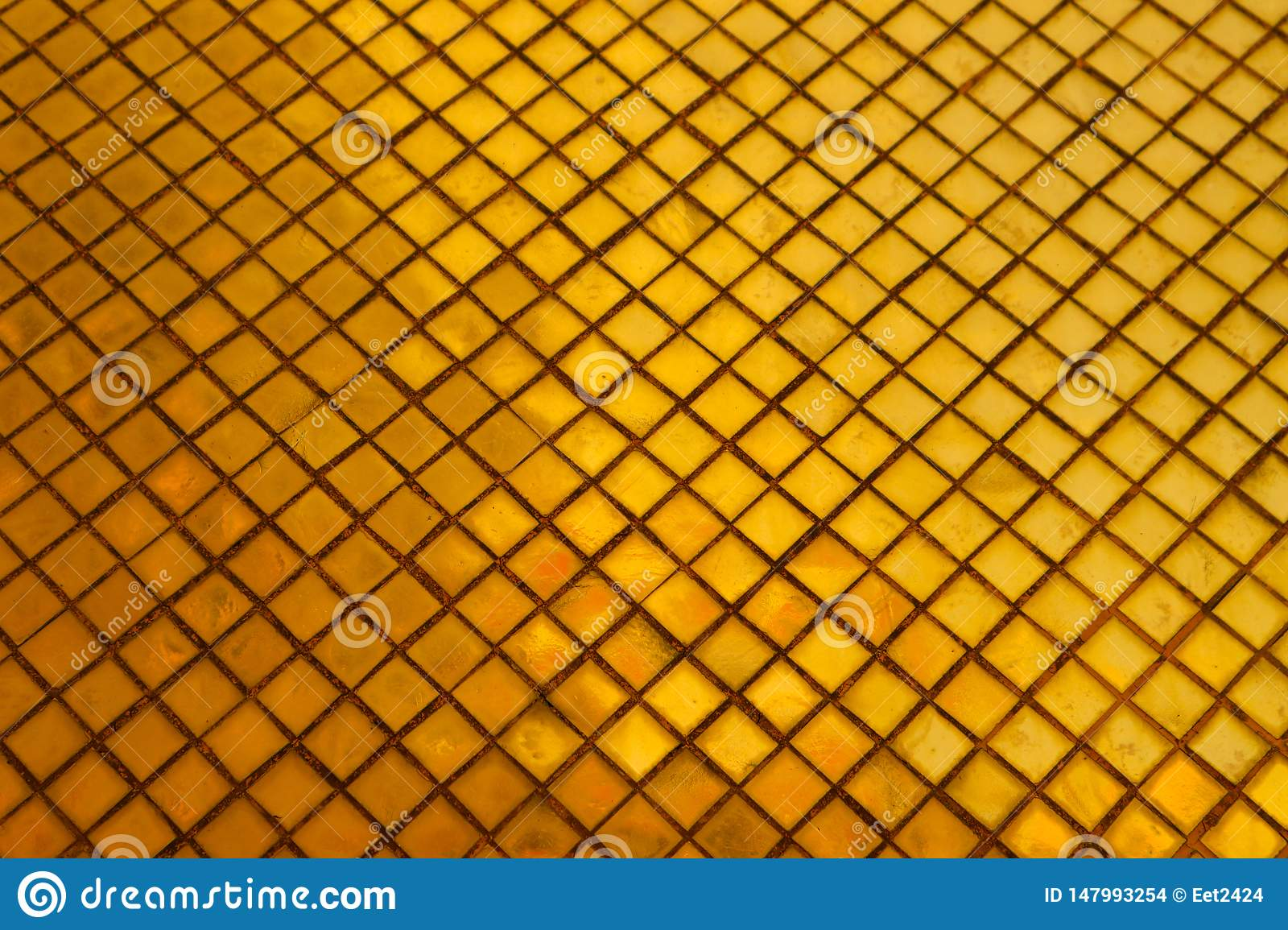 Beautiful closeup textures abstract tiles and gold color glass wall background and art wallpaper