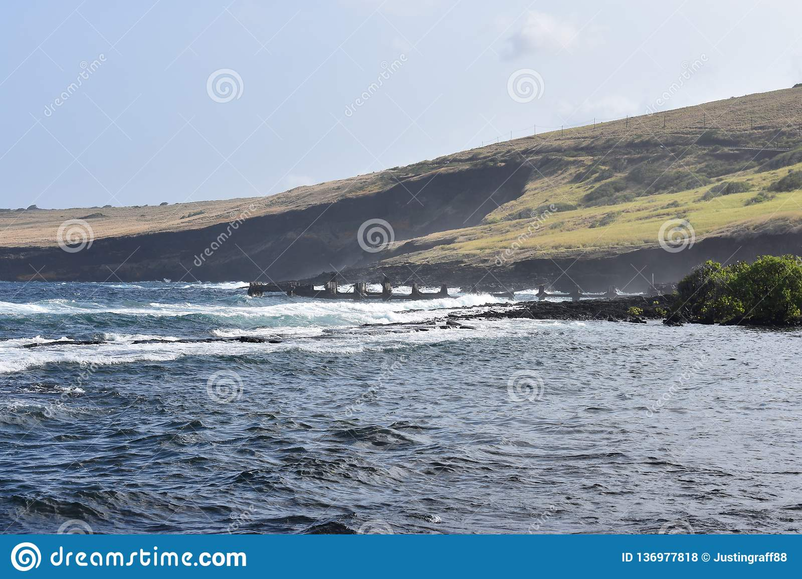 Beautiful Coastal shoreline in Hawaii with waves slowly crashing on the shore