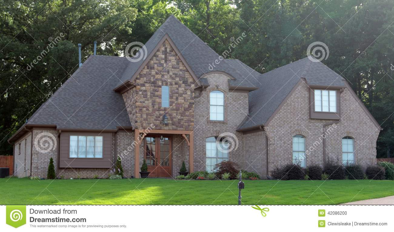 Beautiful cobblestone and brown brick suburban home stock for Cobblestone house